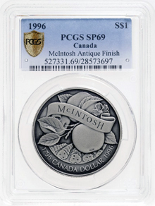 A 1996 McIntosh silver dollar trial piece offered in the sale, with an antique finish, it is one of two known examples.