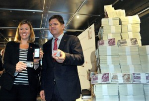 Canadian Tire's Carol Deacon, SVP of Loyalty and Digital, left, and COO Allan MacDonald unveil the new e-Money during a news conference held in a bank vault in Toronto.