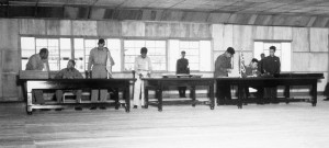 UN delegate William Harrison (seated left) and Korean People's Army and Chinese People's Volunteer Army delegate General Nam Il (seated right) sign the Korean Armistice Agreement at P'anmunjŏm, Korea, on July 27, 1953.