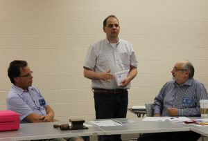 Jared Stapleton (centre) promotes Toronto Coin Expo at a North York Coin Club (NYCC) meeting alongside NYCC President Bill O'Brien (left) and First Vice-President Henry Nienhuis (right).