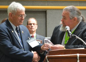 Clifford Mishler (left) receives an RCNA President's Award from then-Past President William Waychison in 2014.