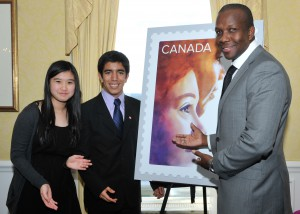 Canadian track and field legend Donovan Bailey alongside youth from Big Brothers Big Sisters' mentoring programs, which were commemorated on a Canada Post stamp marking 100 years of service in Canada.