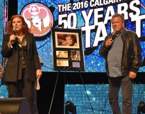 Siân Matthews, chair of Canada Post's board of directors, presented Canadian actor William Shatner with a framed memento today at the Calgary Comic and Entertainment Expo.