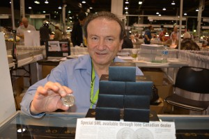 Joe Iorio, owner of J&M Coin and Jewellery Ltd., of Vancouver, B.C. displays a silver maple leaf with a ANA privy mark. The coins are only available at the World's Fair of Money exclusively through J&M.