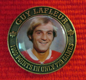 This Guy Lafleur mediallion was part of the Canadian NHL Legends official Hockey Hall of Fame Medallion Collection. It was a 22 medallion set issued in 2004 that also included a folder to hold the medallions. Each medallion measures 1.25 inches in diameter and featured a photo of the player, his name and a stat on the front. The back depicts his jersey and number.