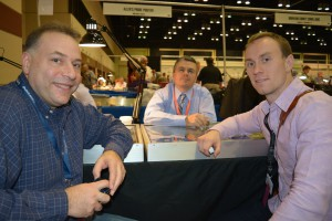 Brian Bell, left, of Geoffrey Bell Auctions, Sandy Campbell of Proof Positive and dealer Oliver Macinski.