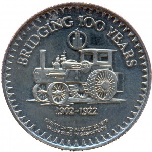 """The coin's reverse featured an antique tractor beneath the inscription """"BRIDGING 100 YEARS"""" and above the dates """"1902-1922"""", during which Saskatoon experienced exponential growth."""