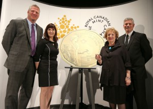 Date: March 8, 2016 From left, John Young (president and CEO of the Canadian Museum for Human Rights), Bonnie Staples-Lyon (Royal Canadian Mint board member), Lila Goodspeed (chairwoman of the Nellie McClung Foundation) and Tom Roche (senior director of manufacturing, Royal Canadian Mint Winnipeg facility) take part in the Royal Canadian Mint's unveiling of the special one-dollar circulation coin to commemorate the 100th anniversary of Canadian women gaining the right to vote. The coin was unveiled at the Canadian Museum for Human Rights in Winnipeg, Man. Photo by Jason Halstead/CPimages