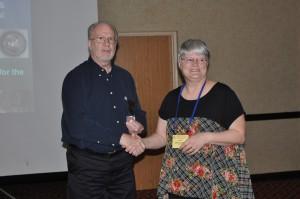 Judy Blackman gave a educational symposium presentation on Little Gems 1800 - 1920. Here, Scott E. Douglas, chair of the Educational Symposium, thanks Blackman for her insightful presentation.